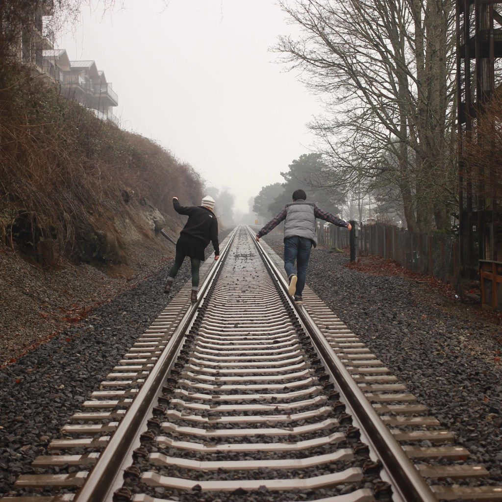 People on Train Tracks